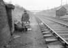 SD640509B, Man marking Ordnance Survey minor control revision point with an arrow in 1950s