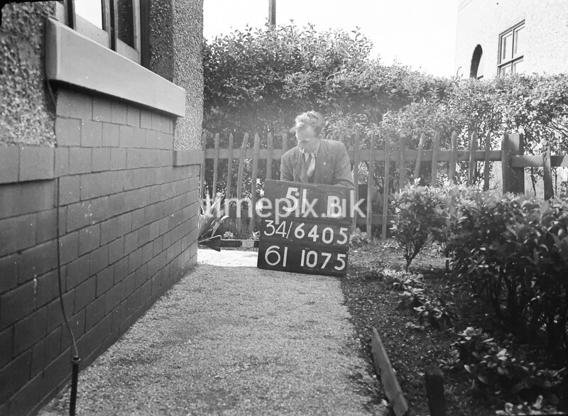 SD640551B, Man marking Ordnance Survey minor control revision point with an arrow in 1940s