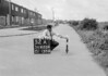 SD620452A, Man marking Ordnance Survey minor control revision point with an arrow in 1940s