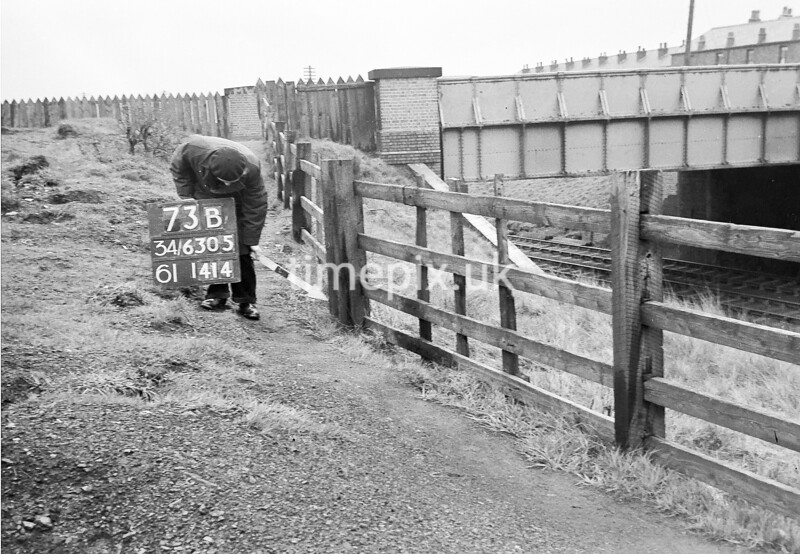 SD630573B, Man marking Ordnance Survey minor control revision point with an arrow in 1950s