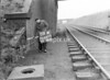 SD640509A, Man marking Ordnance Survey minor control revision point with an arrow in 1950s