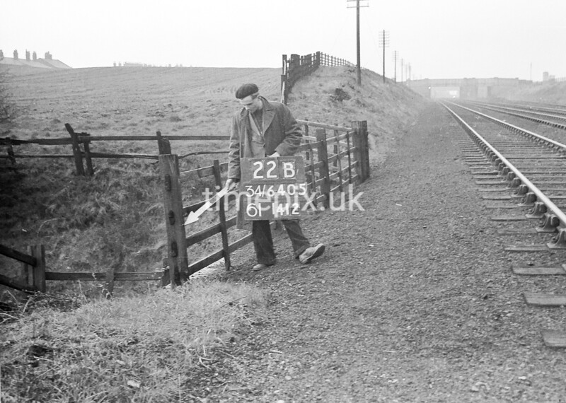 SD640522B, Man marking Ordnance Survey minor control revision point with an arrow in 1950s