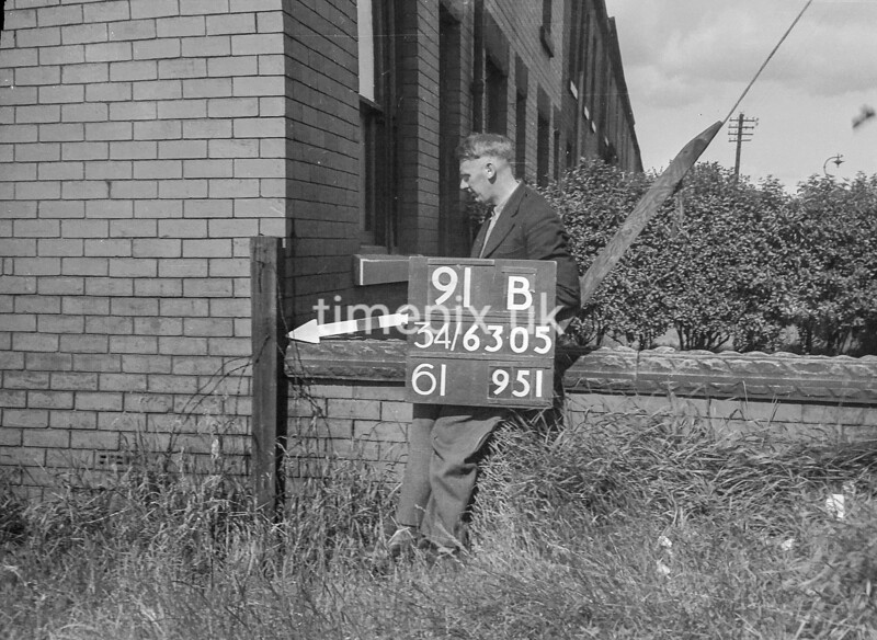 SD630591B, Man marking Ordnance Survey minor control revision point with an arrow in 1940s