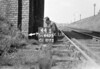 SD640544S, Man marking Ordnance Survey minor control revision point with an arrow in 1940s