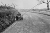 SD640884A, Man marking Ordnance Survey minor control revision point with an arrow in 1940s