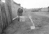 SD630593A, Man marking Ordnance Survey minor control revision point with an arrow in 1950s