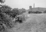 SD630409A, Man marking Ordnance Survey minor control revision point with an arrow in 1940s