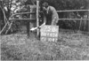 SD640675B, Man marking Ordnance Survey minor control revision point with an arrow in 1940s