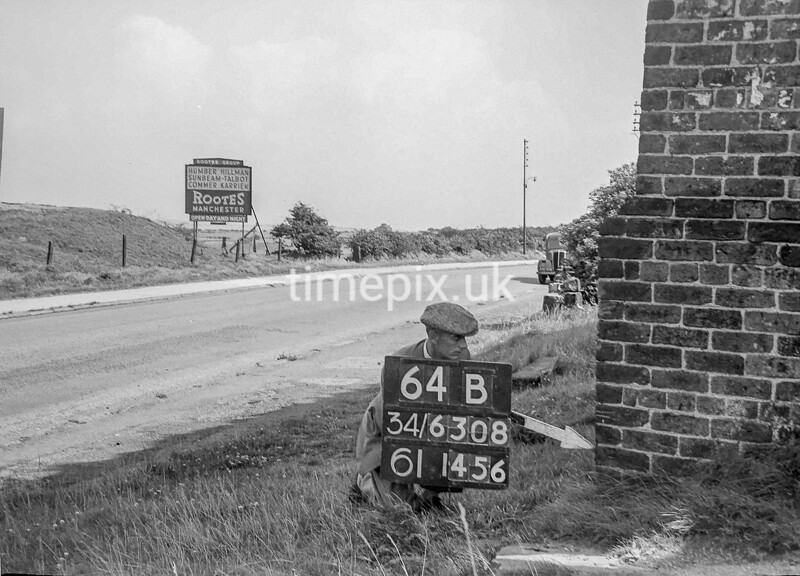 SD630864B, Man marking Ordnance Survey minor control revision point with an arrow in 1950s