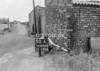 SD620450A, Man marking Ordnance Survey minor control revision point with an arrow in 1940s