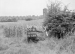 SD630409B, Man marking Ordnance Survey minor control revision point with an arrow in 1940s