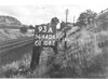 SD640693A, Man marking Ordnance Survey minor control revision point with an arrow in 1940s
