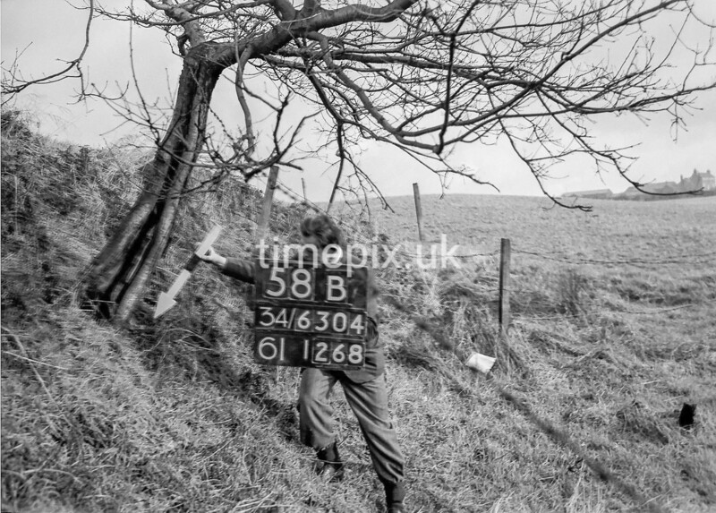 SD630458B, Man marking Ordnance Survey minor control revision point with an arrow in 1940s