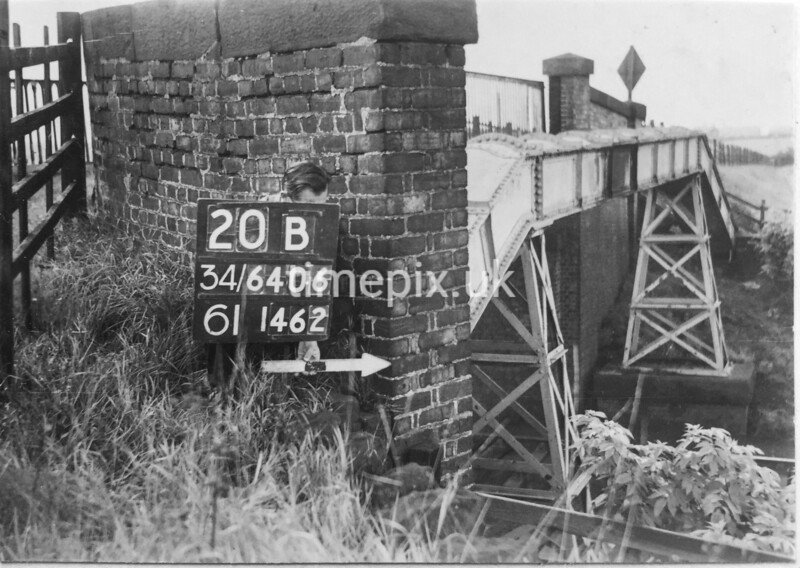 SD640620B, Man marking Ordnance Survey minor control revision point with an arrow in 1950s