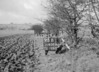 SD630495B, Man marking Ordnance Survey minor control revision point with an arrow in 1940s