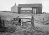 SD620491A, Man marking Ordnance Survey minor control revision point with an arrow in 1940s
