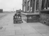 SD630092A, Man marking Ordnance Survey minor control revision point with an arrow in 1940s