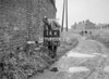 SD640014K, Man marking Ordnance Survey minor control revision point with an arrow in 1940s