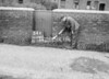 SD640254A, Man marking Ordnance Survey minor control revision point with an arrow in 1940s