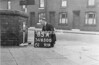 SD650085A, Man marking Ordnance Survey minor control revision point with an arrow in 1940s