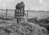 SD630175B, Man marking Ordnance Survey minor control revision point with an arrow in 1940s