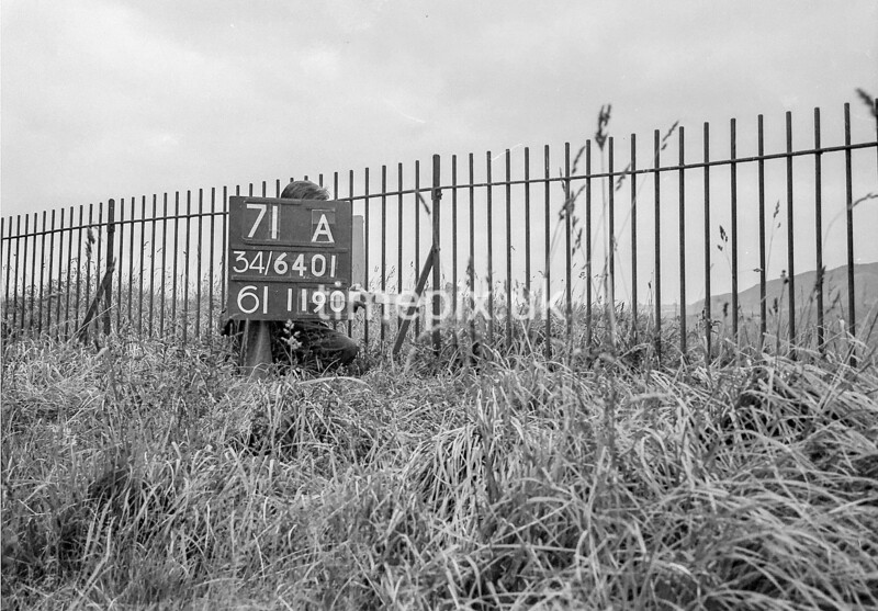 SD640171A, Man marking Ordnance Survey minor control revision point with an arrow in 1940s
