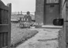 SD640144A, Man marking Ordnance Survey minor control revision point with an arrow in 1940s