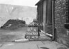 SD630387A, Man marking Ordnance Survey minor control revision point with an arrow in 1940s
