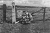 SD650165B, Man marking Ordnance Survey minor control revision point with an arrow in 1940s