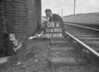 SD630208A, Man marking Ordnance Survey minor control revision point with an arrow in 1940s