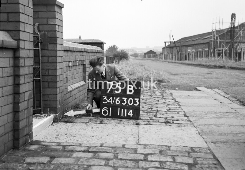 SD630375B, Man marking Ordnance Survey minor control revision point with an arrow in 1940s