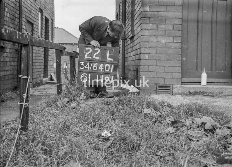 SD640122L, Man marking Ordnance Survey minor control revision point with an arrow in 1940s