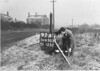 SD650397A, Man marking Ordnance Survey minor control revision point with an arrow in 1940s