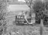 SD640076A, Man marking Ordnance Survey minor control revision point with an arrow in 1940s