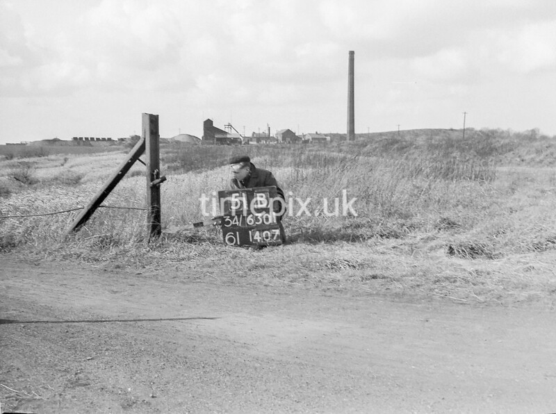 SD630151B, Man marking Ordnance Survey minor control revision point with an arrow in 1940s