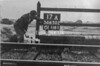 SD650217A, Man marking Ordnance Survey minor control revision point with an arrow in 1940s
