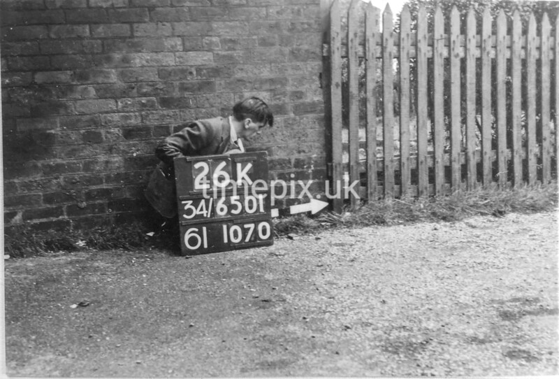 SD650126K, Man marking Ordnance Survey minor control revision point with an arrow in 1940s