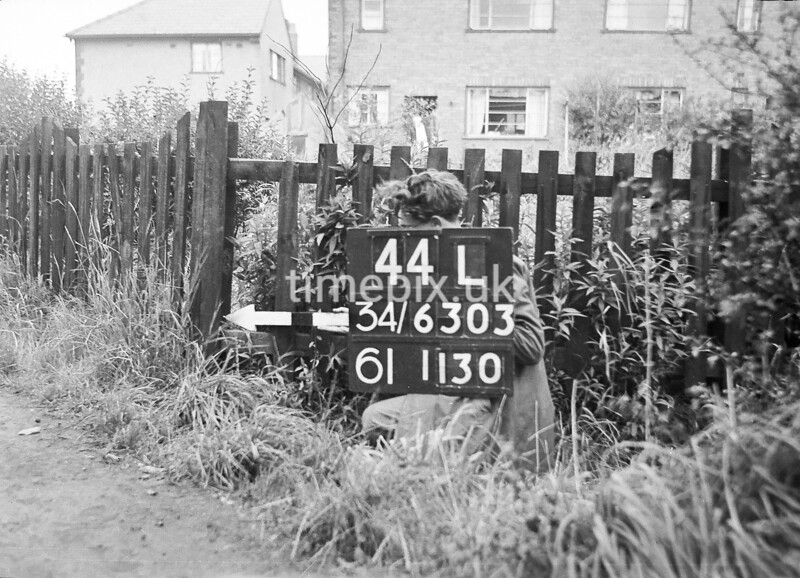 SD630344L, Man marking Ordnance Survey minor control revision point with an arrow in 1940s