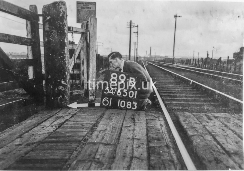 SD650189B, Man marking Ordnance Survey minor control revision point with an arrow in 1940s
