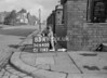SD640083A, Man marking Ordnance Survey minor control revision point with an arrow in 1940s