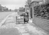 SD640138A, Man marking Ordnance Survey minor control revision point with an arrow in 1940s