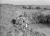 SD640327A, Man marking Ordnance Survey minor control revision point with an arrow in 1940s