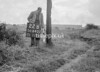 SD640222B, Man marking Ordnance Survey minor control revision point with an arrow in 1940s