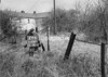SD630126B, Man marking Ordnance Survey minor control revision point with an arrow in 1950s