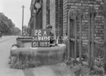 SD640022A, Man marking Ordnance Survey minor control revision point with an arrow in 1940s