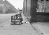 SD640092A, Man marking Ordnance Survey minor control revision point with an arrow in 1940s