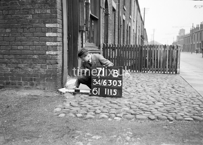 SD630371B, Man marking Ordnance Survey minor control revision point with an arrow in 1940s