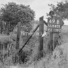SD640149B, Man marking Ordnance Survey minor control revision point with an arrow in 1940s