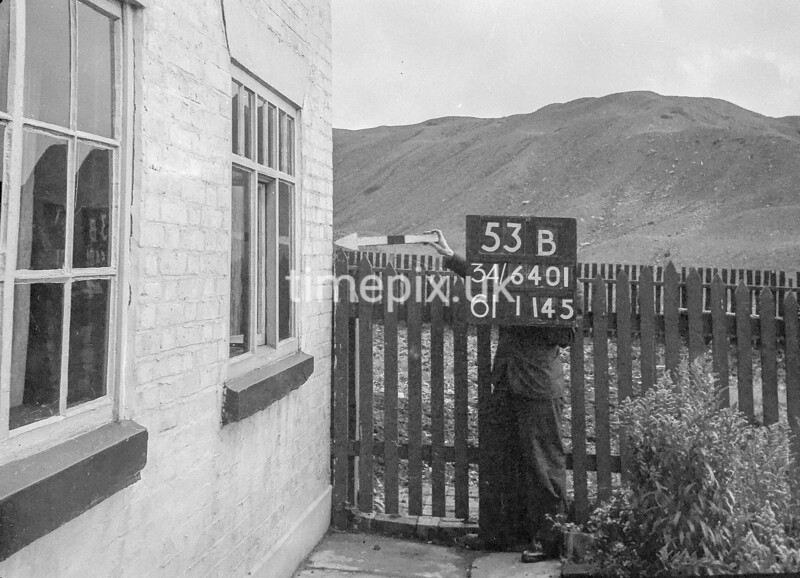 SD640153B, Man marking Ordnance Survey minor control revision point with an arrow in 1940s