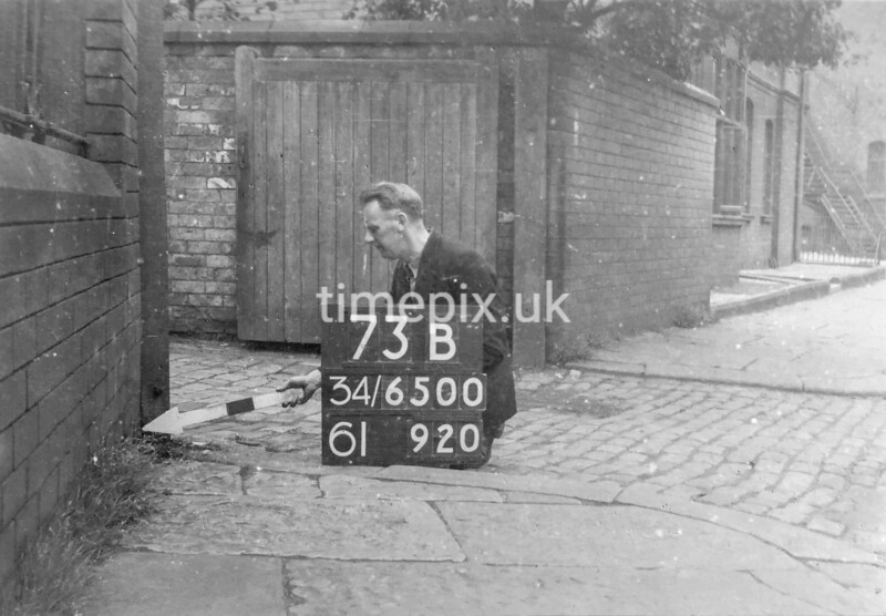 SD650073B, Man marking Ordnance Survey minor control revision point with an arrow in 1940s